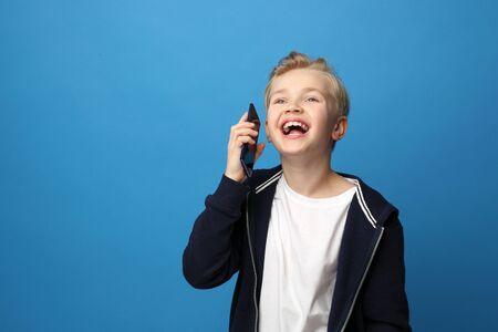 Child talking on a modern smartphone.