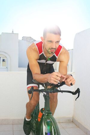 Training on a spinning bike. Sports training on a stationary exercise bike. Archivio Fotografico