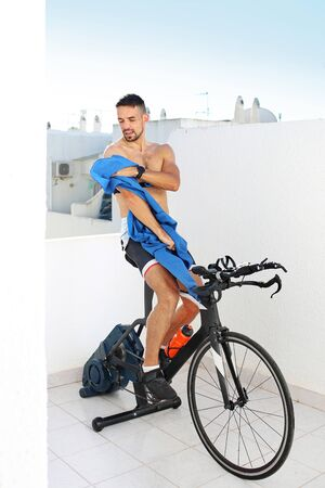 Indoor cycling, cycling training. Sports training on a stationary exercise bike.