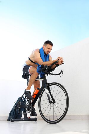 Indoor cycling, spinning cycling training. Sports training on a stationary exercise bike.