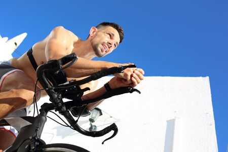 Workout at home. Training on a spinning bike. Sports training on a stationary exercise bike. Archivio Fotografico