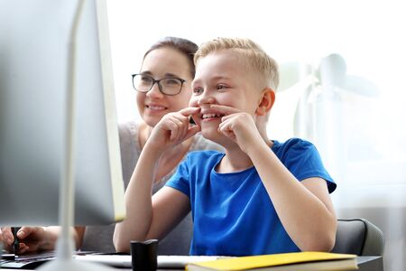 E-learning. Distance learning. The child learns via the internet, online lesson.