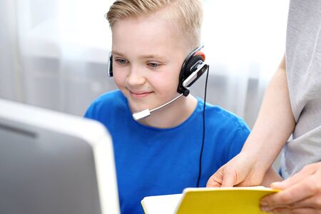 Distance learning. E-learning. The child learns via the internet, online lesson.
