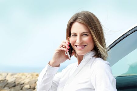 Attractive woman talking on the phone. Portrait of a young businesswoman woman talking on the phone Фото со стока