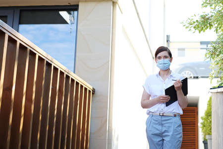 Work during the epidemic. A woman wearing a face mask goes to the office.