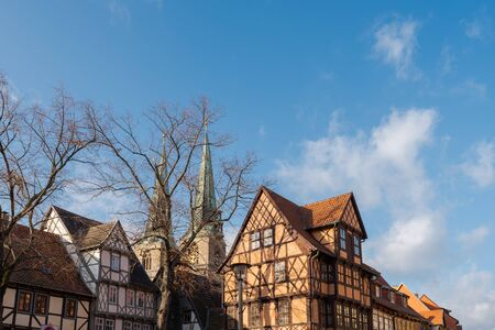 Old half-timbered houses in Quedlinburg, Germany on sunny day with clouds