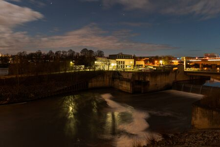 Hydroelectric power plant on the river Danube in Regensburg, Bavaria during cloudy night with stars