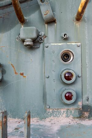 Detail of broken tail lights of soviet tank
