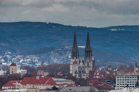 Scenic view of the town of Regensburg with the cathedral and various church towers with snow covered landscape in winter