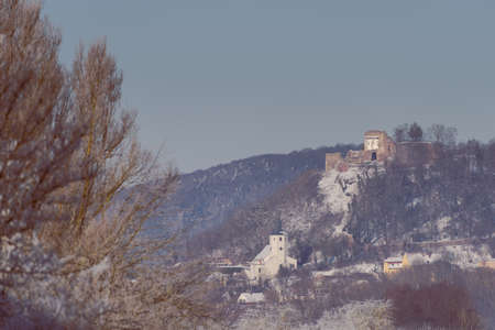 Parish Church and castle ruin of Donaustauf near Regensburg in Bavaria on cold winter day with snow and rime