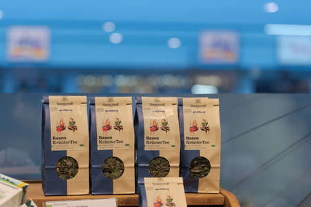 Regensburg, Germany - 2021 02 05: Packs of herbal tea from brand Sonnentor standing on display in organic super market with German label