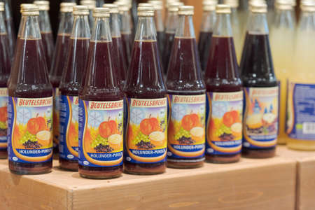 Regensburg, Germany - 2021 02 05: Bottles of Beutelsbacher elder punch standing on display in organic super market with German label