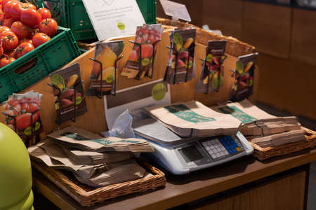 Regensburg, Germany - 2021 02 05: Station with scale and paper bags for customer self-service in organic super market