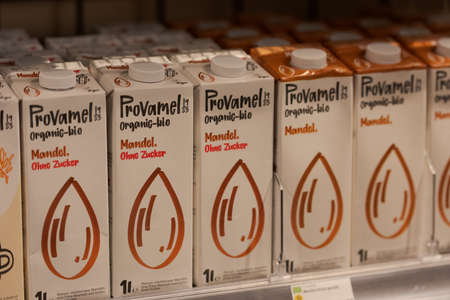 Regensburg, Germany - 2021 02 05: Cartons with boxed almond milk drink of brand Provamel standing in shelf on display in organic super market