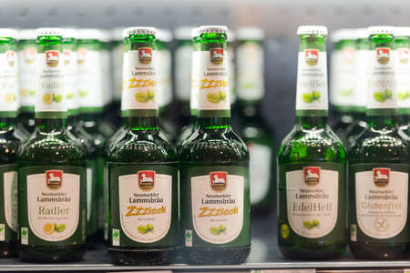 Regensburg, Germany - 2021 02 05: Refrigerated section with bottles of german brewery Neumarkter Lammsbräu craft beer behind glass doors on display in organic super market