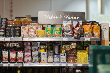 Regensburg, Germany - 2021 02 05: Shelf in aisle in german organic supermarket with sign meaning
