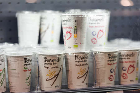 Regensburg, Germany - 2021 02 05: Cartons with boxed soy yoghurt of brand Provamel standing in shelf in refrigerated section on display in organic super market