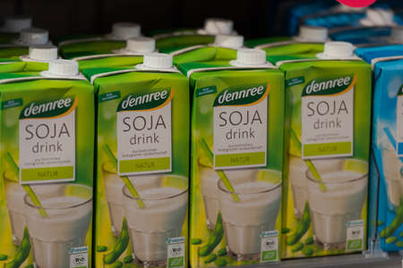 Regensburg, Germany - 2021 02 05: Cartons with soy drink of brand dennree standing in shelf on display in organic super market 新聞圖片