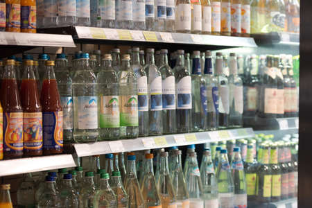 Regensburg, Germany - 2021 02 05: Shelf with different glass bottles of mineral water in German organic super market 新聞圖片