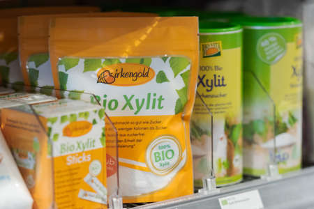 Regensburg, Germany - 2021 02 05: Shelves with xylit of different brands on display in organic super market