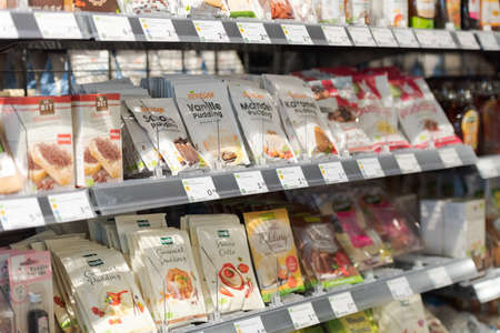 Regensburg, Germany - 2021 02 05: Shelves with baking ingredients and instant pudding mixes on display in organic super market 新聞圖片