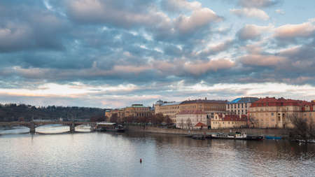 View from the Charles bridge in Prague over the Vlatva river on cloudy day Banco de Imagens