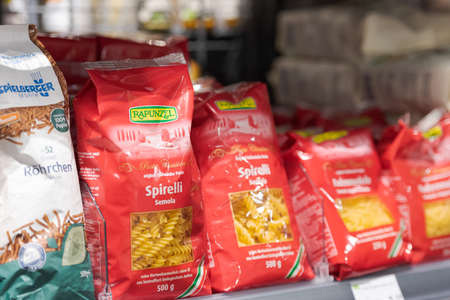 Regensburg, Germany - 2021 02 05: Plastic free bags with spirelli pasta of brand Rapunzel on display in german organic super market