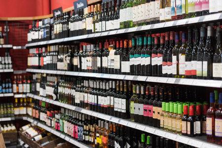 Regensburg, Germany - 2021 02 05: Shelves with wine bottles from various brands on display in German organic super market