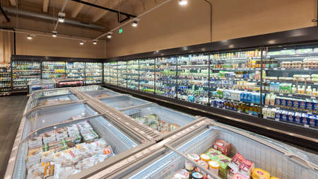 Munich, Germany - 2021 02 05: Overview of fridge section and freezing compartment in german organic supermarket Editorial