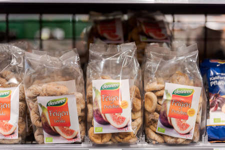 Munich, Germany - 2021 02 05: Plastic free bags made from wooden fibers with whole figs of brand dennree in shelf on display in german organic supermarket