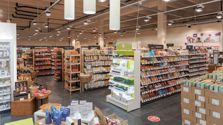 Munich, Germany - 2021 02 05: Aisles with different food products from various brands on display in german organic supermarket Editorial