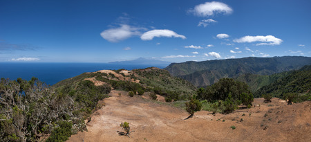 vallehermoso: La Gomera - Trail on a mountain ridge above Vallehermoso to the Buenavista with a panoramic view to the mountains, the sea and the neighboring island of Tenerife with the Teide