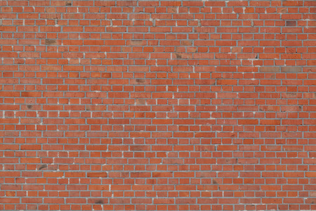 Industrial red brick wall with gray gaps in detail photo