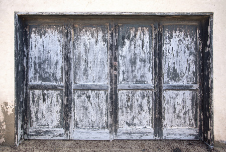 Large weathered wooden door in gray blue anthracite on Lanzarote, Canary Islands, Spain. photo