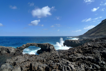 rock arch: Large rock arch at Charco Manso north of Echedo, at the northern tip Punta Norte of El Hierro, Canary Islands, Spain. Stock Photo