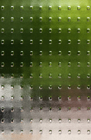 Fluted textured glass with translucent color fields in green, gray, silver, brown.