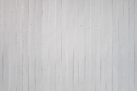 exposed concrete: Close-up of a white wall with vertical striped pattern of exposed concrete Stock Photo