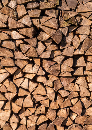 Stacked firewood of spruce in vertical format