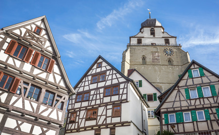 Detail of the old town of Herrenberg, Germany, with half-timbered houses and the church Collegiate Church.