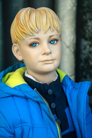 anorak: Mannequin - Boy with blond hair and blue eyes wears a blue sweater and anorak