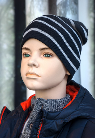 conspicuous: Mannequin - Boy with conspicuous eyebrows and green eyes wears sweater, anorak and beanie.