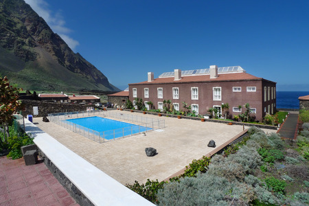 Look over the Hotel Balneario and the mountainside of the Rincon de la Cerca in Pozo de la Salud at the western end of the El Golfo valley on El Hierro, Canary Islands, Spain.