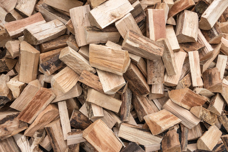 disorderly: Detail shot of a disorderly heap of short logs