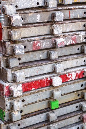modulus: Close up of twelve old, dirty, stacked scaffolding decks Stock Photo