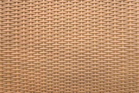 braiding: Detail of a light brown braiding of a chair made of plastic