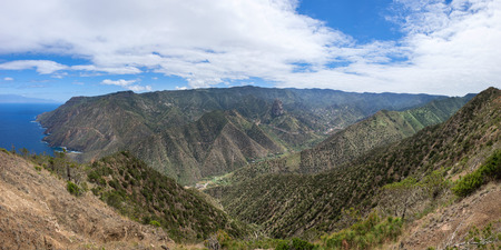 Panorama over the valley of Vallehermoso with the central Roque El Cano to the north coast. At the back left the island of Tenerife.