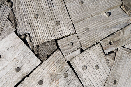 peg board: Abstract pattern of gray, weathered wooden boards with embedded wooden dowels Stock Photo
