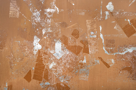 close p: Abstract pattern of remnants of adhesive tape on a brown metal plate