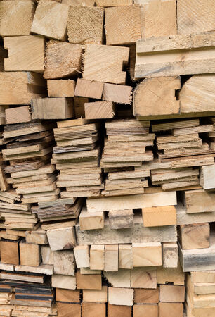 sawed: Detail shot of a stack with sawed and piled squared timbers and THEREFORE multi-glued boards