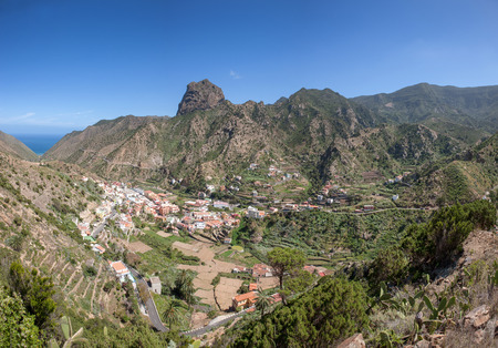 Center of Vallehermoso with the Roque El Cano in La Gomera, Canary Islands, Spain. Taken from the ascent to the Montana Blanca.